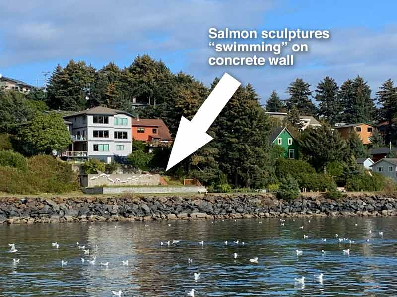 Wide angle shot of salmon art on concrete wall in Kodiak, Alaska